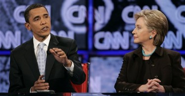 Sen. Barack Obama, D-Ill., left, answers a question as Sen. Hillary Rodham Clinton, D-N.Y., looks on during the Democratic presidential debate in Los Angeles, Thursday, Jan. 31, 2008. (AP Photo/Chris Carlson)